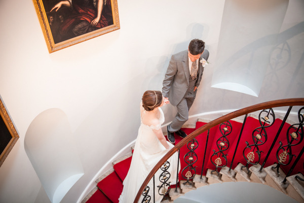 Bride and groom walking up stairs at Belair House