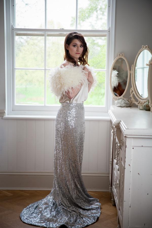 Bride in silver glittery skirt and fluffy shrug