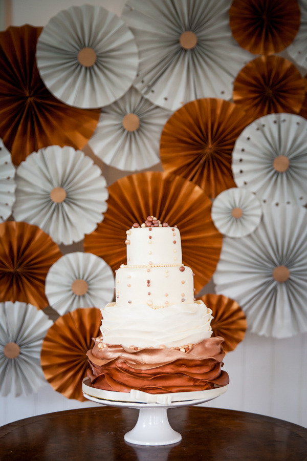 Wedding cake with copper and grey backdrop