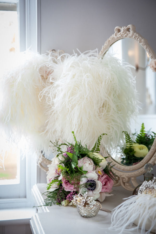 Shrug and wedding bouquet on dressing table