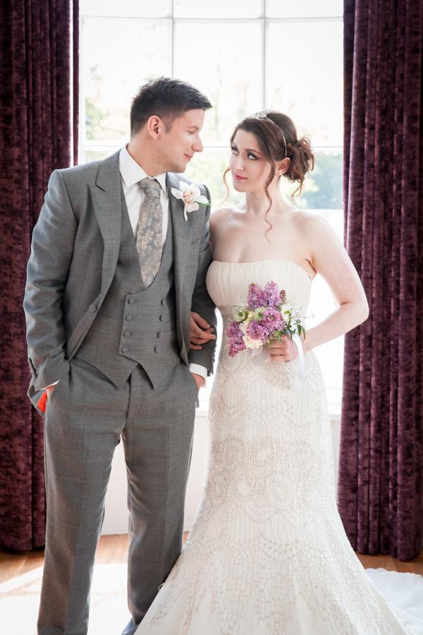 Bride and groom standing in Belair House