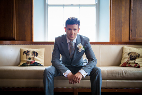 Groom sitting on couch