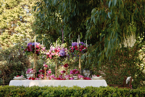 Long wedding table with large floral centrepiece