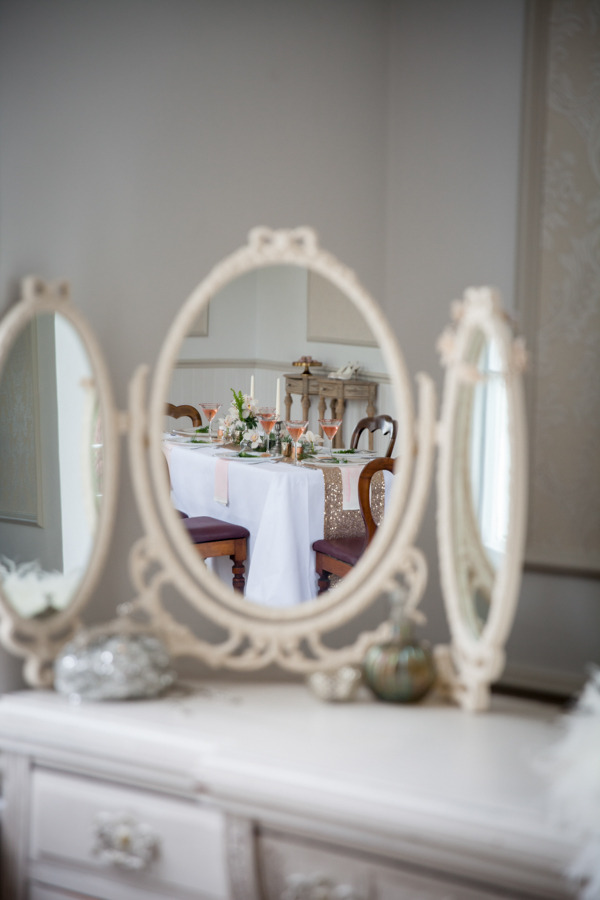 Reflection of wedding table in mirror