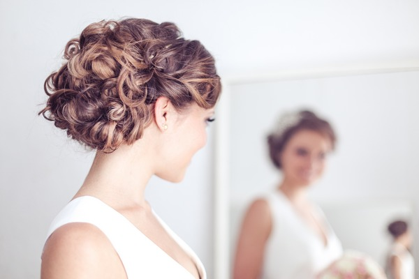 Softly curled bridal hairstyle updo