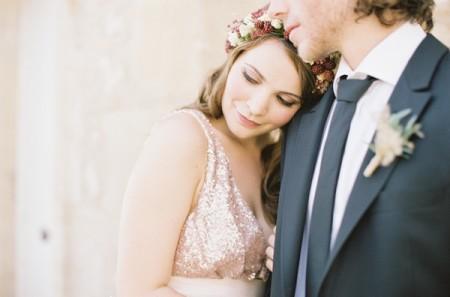 Bride resting head on groom's shoulder
