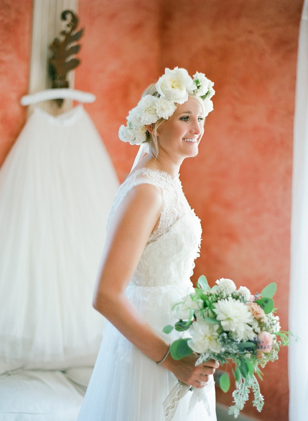 Bride with flower crown holding bouquet