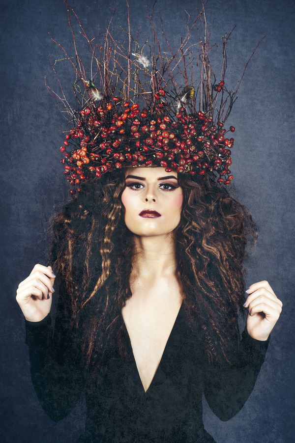 Bride wearing crown of sticks and red berries