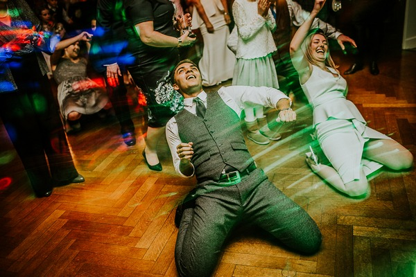 Groom dancing on his knees on wedding dance floor - Picture by Dan Ward Photography
