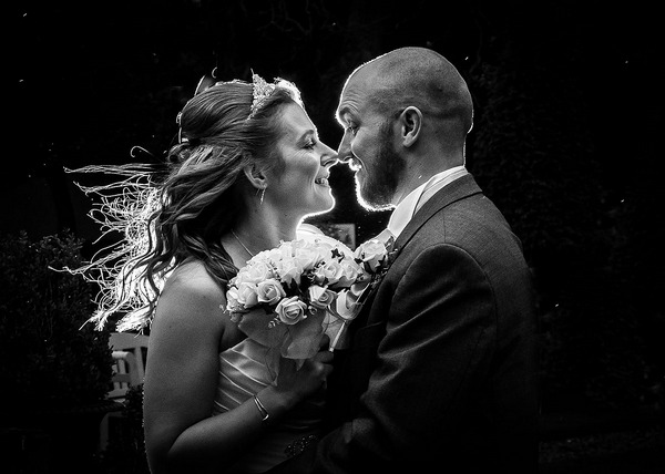 Bride and groom smiling face to face - Picture by Peter Anslow Photography