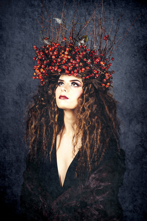 Alternative bride in black dress and winter berry crown