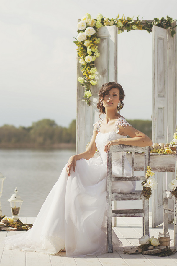 Bride sitting by Lake of Candia in Italy