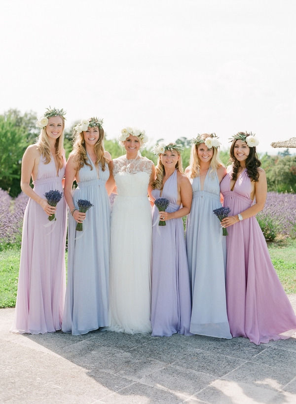 Bride with bridesmaids in pastel bridesmaid dresses