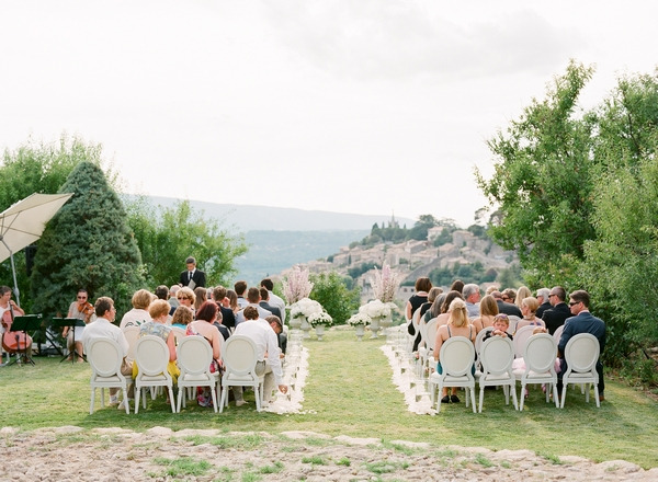 Wedding guests sitting for outdoor ceremony in Bonnieux in Provence