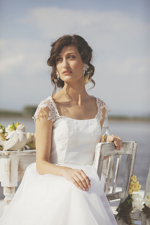 Bride wearing wedding dress with lace detail