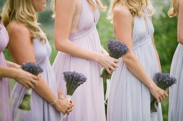Bridesmaids holding lavender bouquets