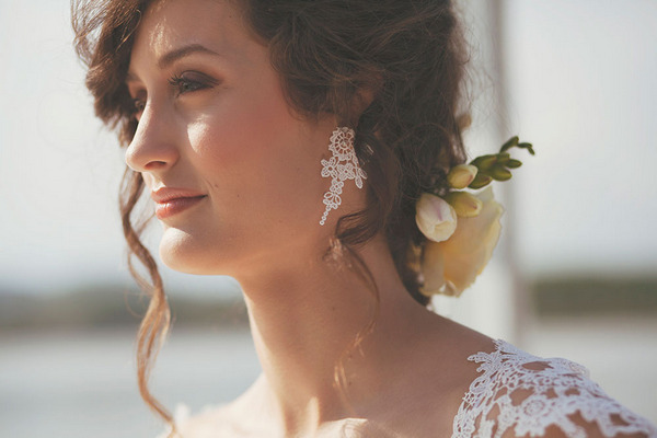 Bride's updo hairstyle and earrings