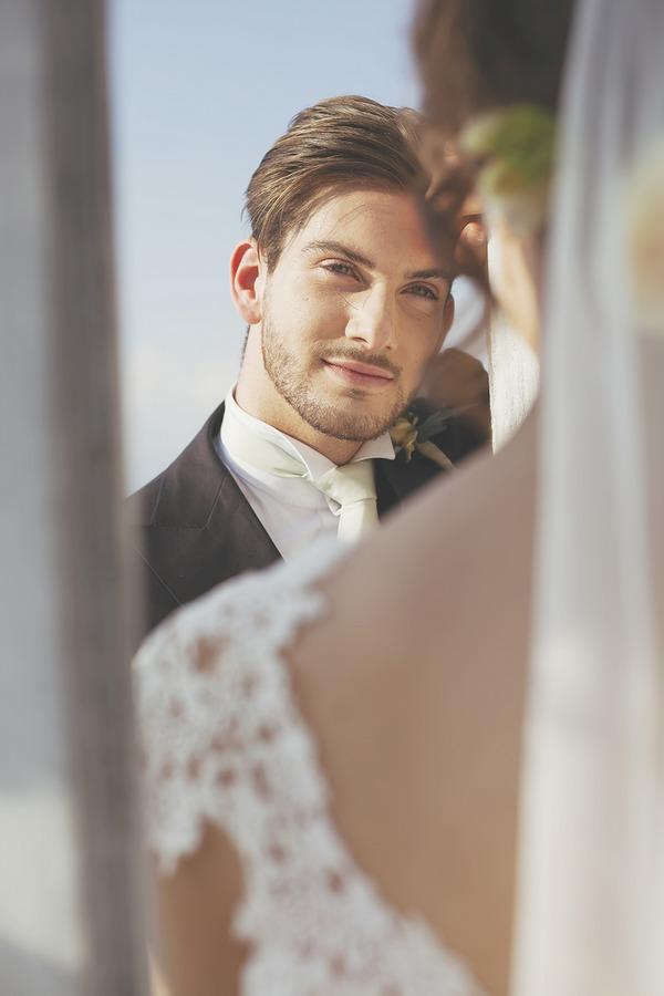 Groom gazing at bride