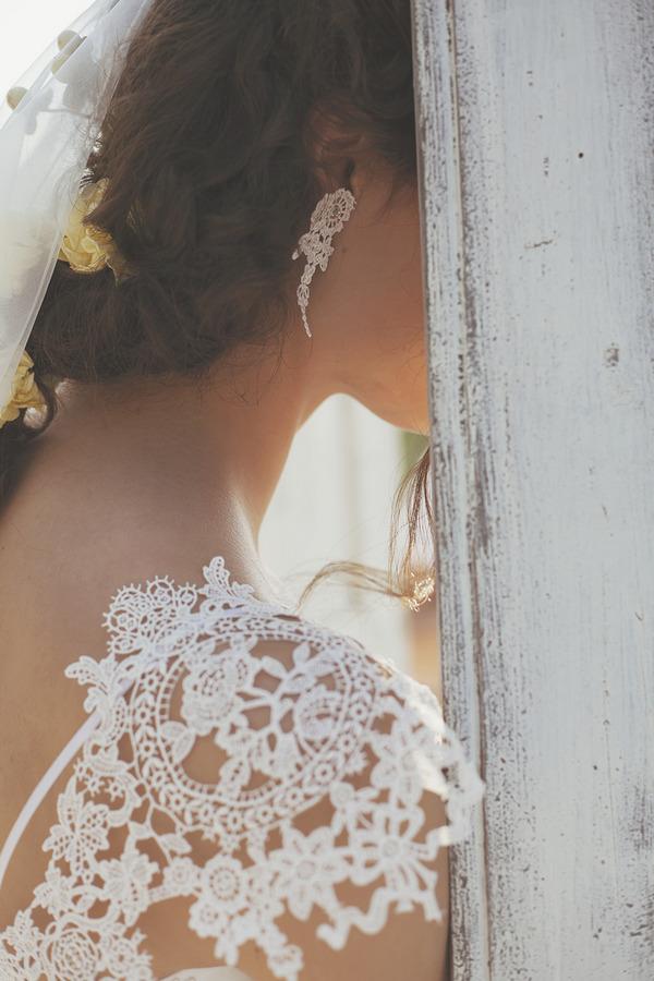 Lace detail on shoulder of bride's dress