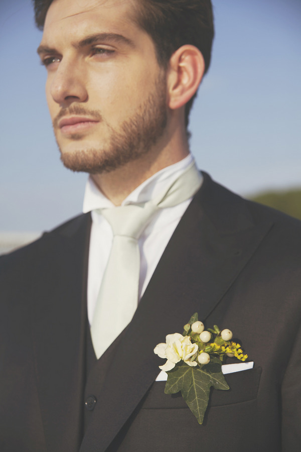 Groom with white cravat and yellow buttonhole