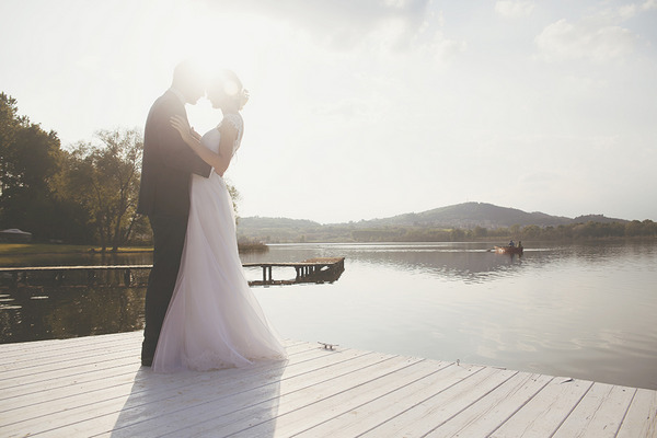 Bride and groom by Lake of Candia in Italy