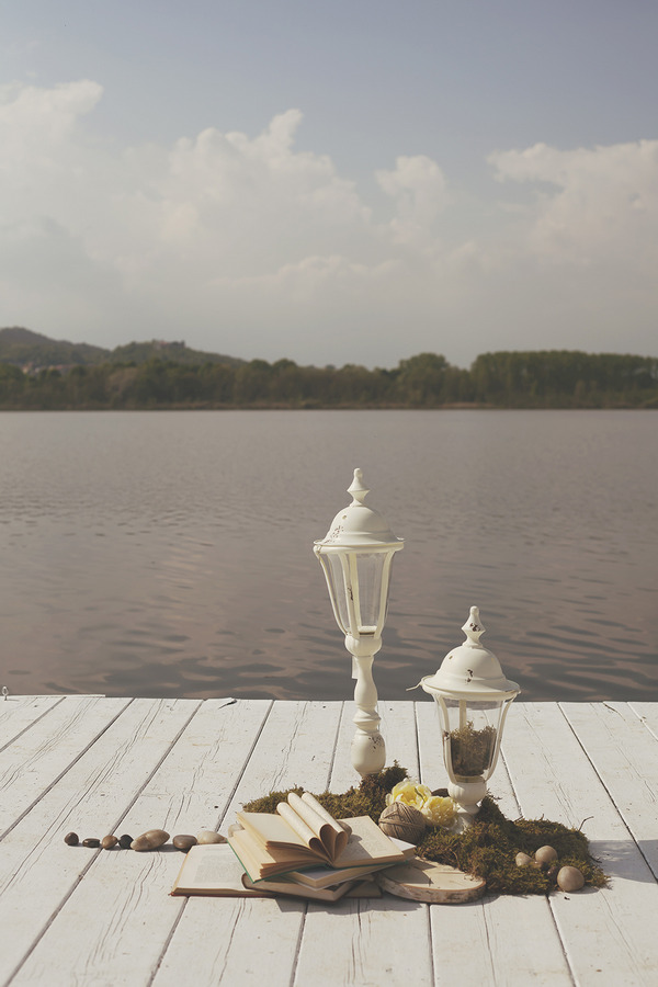 Vintage style lamps by lake in Italy