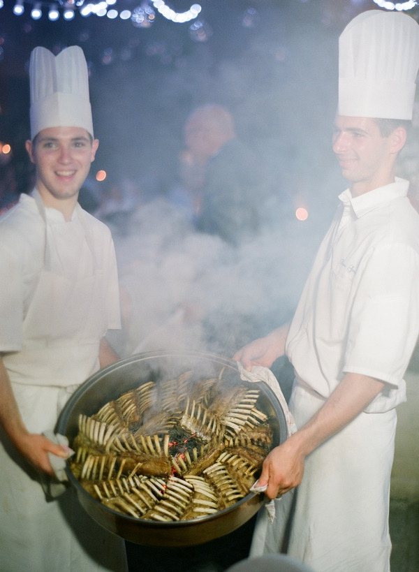Chefs holding wedding food