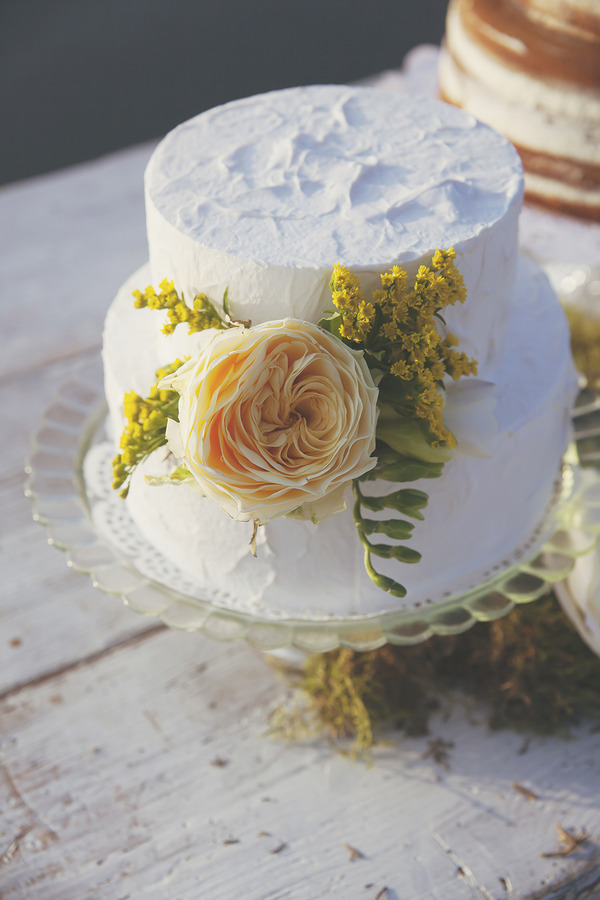 White iced wedding cake with yellow flowers