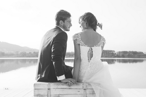 Bride and groom sitting on chest
