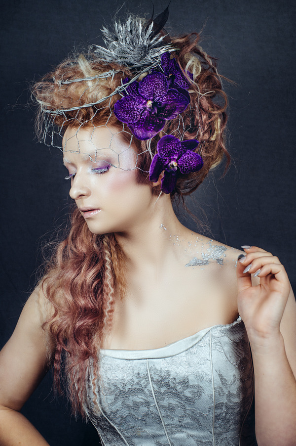 Bride with purple orchids in hair and chicken mesh veil