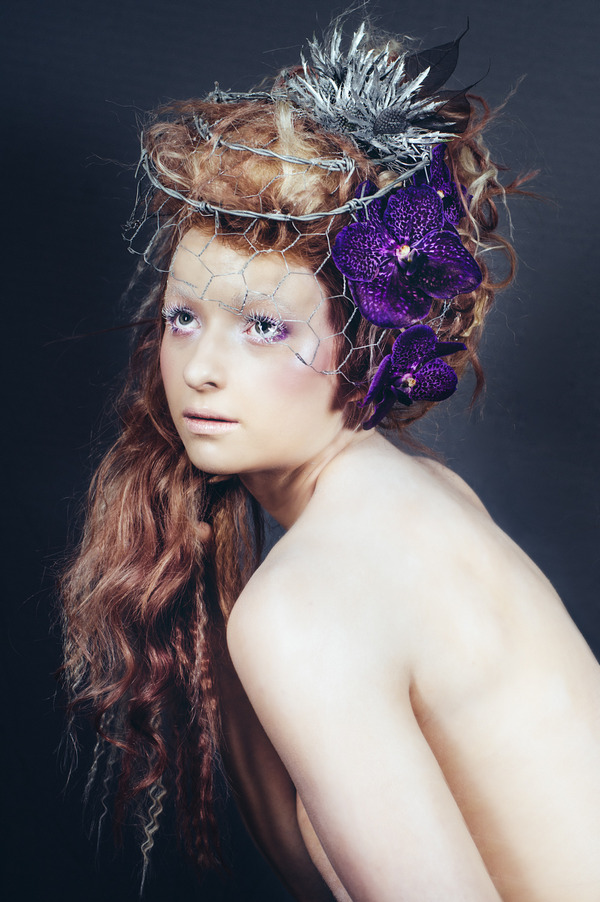 Alternative bride with purple orchids in hair
