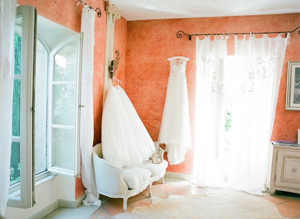 Room with wedding dresses having