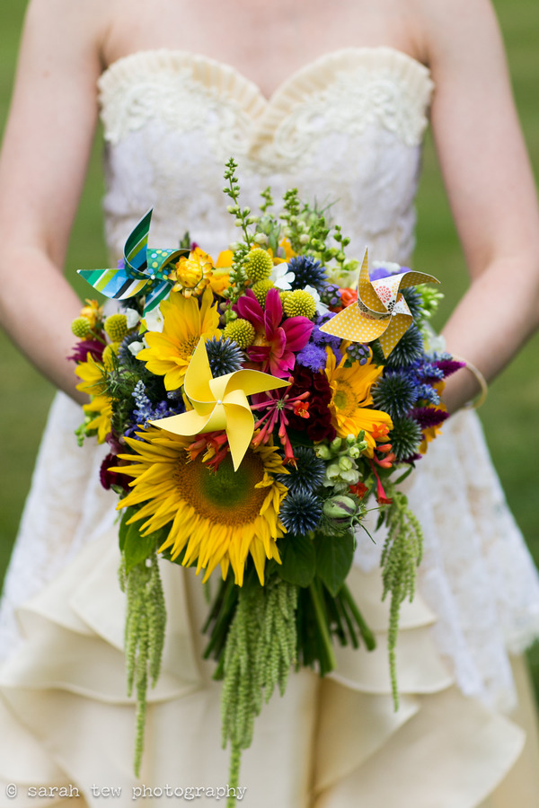 Bride and bold wedding bouquet with pinwheels