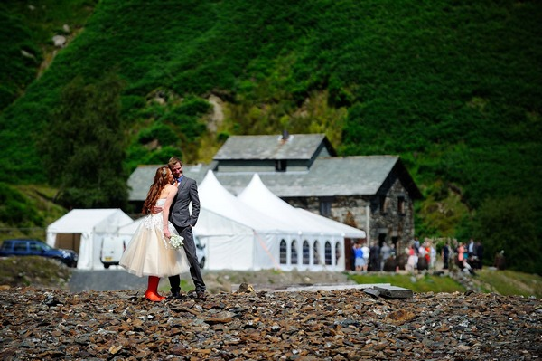 Bride and groom on pebble beach - Picture by Darren Athersmith