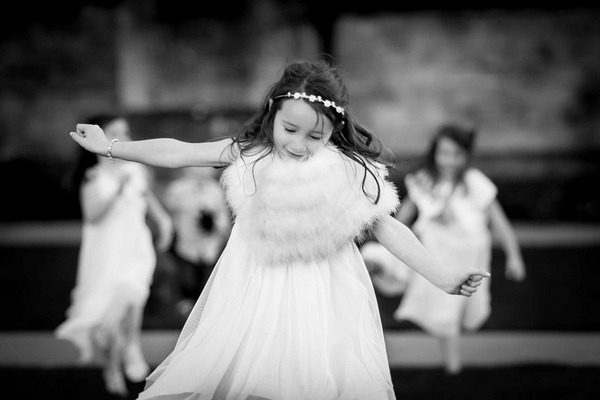 Flower girl running with arms out pretending to be an aeroplane - Picture by Alex Toze