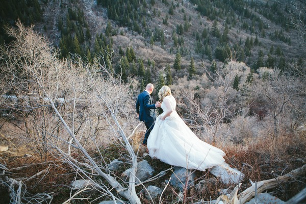Bride and groom walking down hillside - Picture by Tegyn Friedman Photography