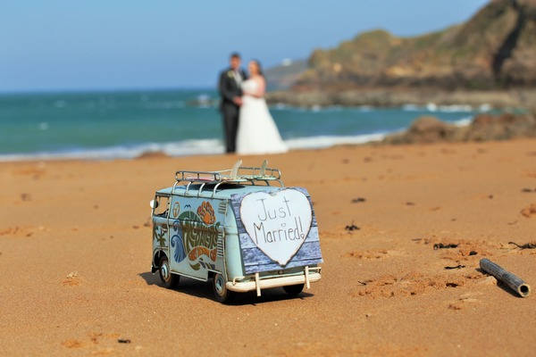 Miniature camper van with Just Married on back on beach - Picture by Once Upon a Wedding Photography