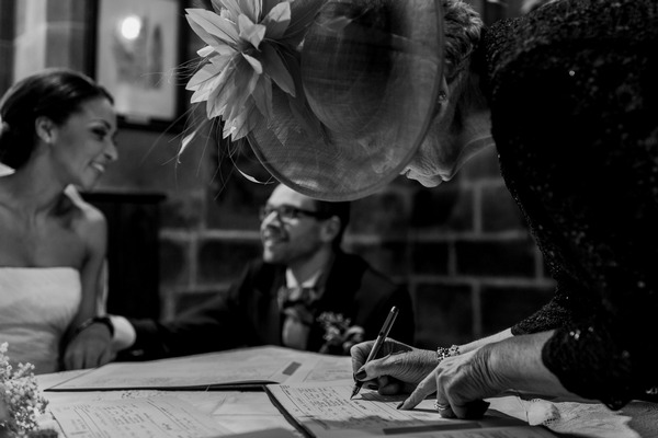 Witness signing marriage register - Picture by Simon Dewey Photography