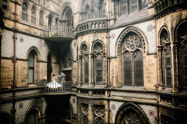 Bride and groom standing on balcony of Manchester Town Hall - Picture by Johnboy Wilson Photography