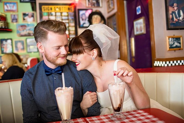 Retro bride and groom drinking milkshake in American diner - Picture by Binky Nixon Photography