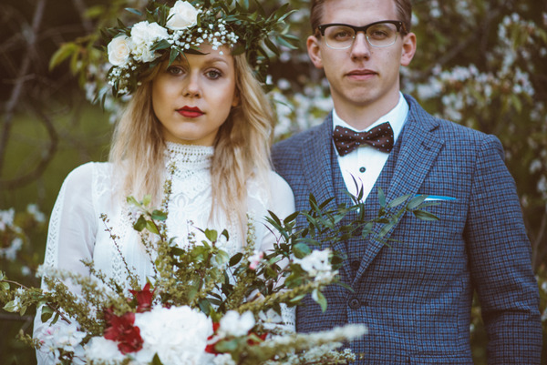 Vintage bride with flower crown standing with groom