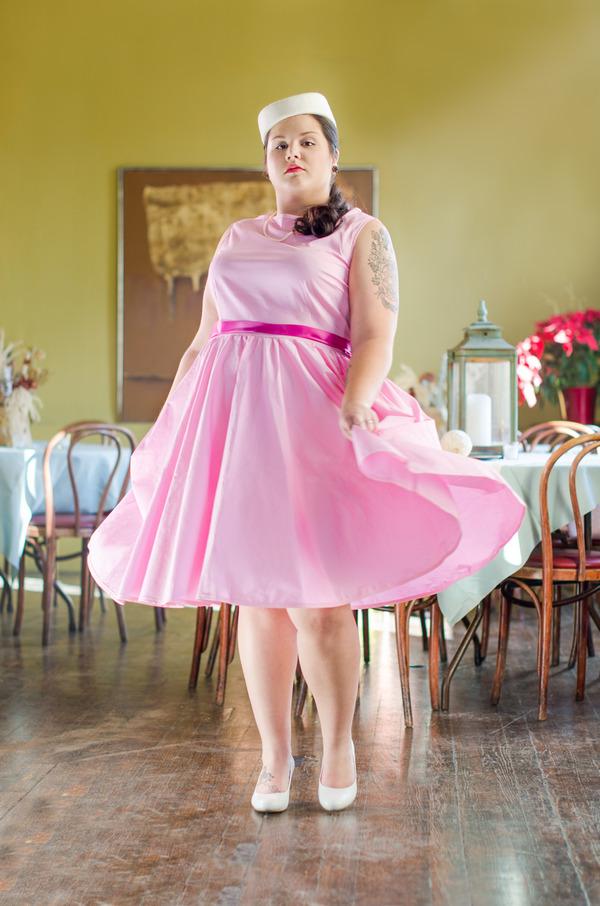 Bride wearing retro pink wedding dress