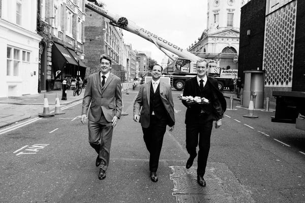 Groomsmen walking to wedding