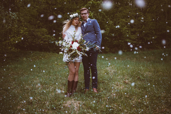 Vintage bride and groom standing on grass