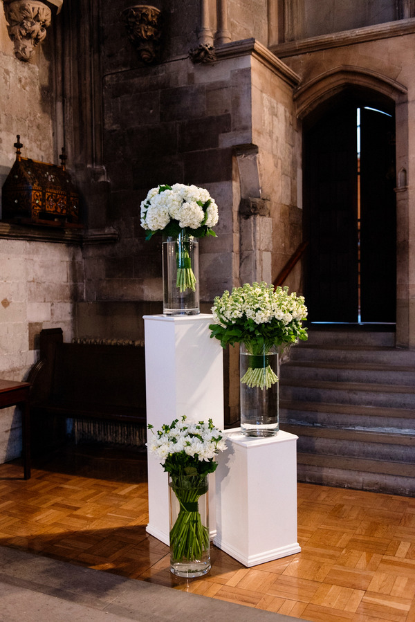 Vases of flowers in church for wedding ceremony
