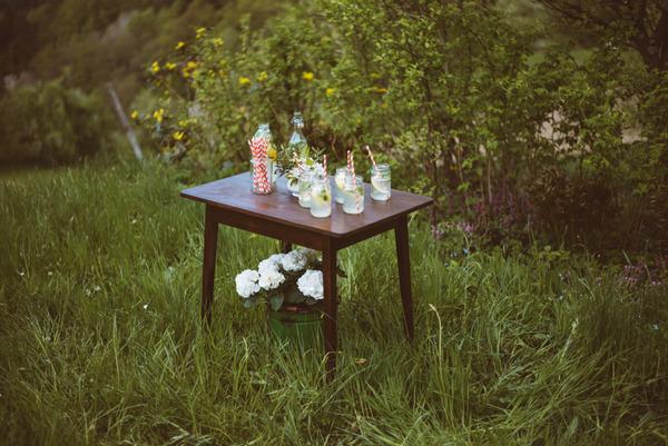 Table with jam jars of lemonade