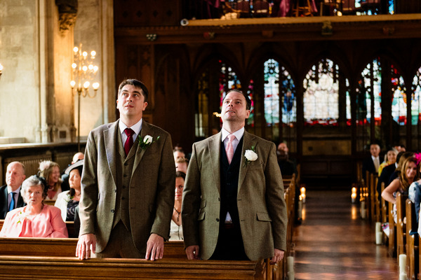 Groom and best man anxiously waiting for bride