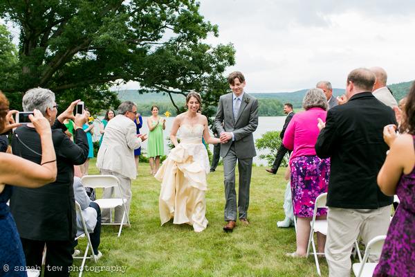 Bride and groom walking back down aisle