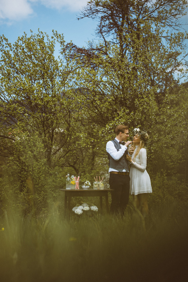 Bride and groom standing by table in Slovenian countryside