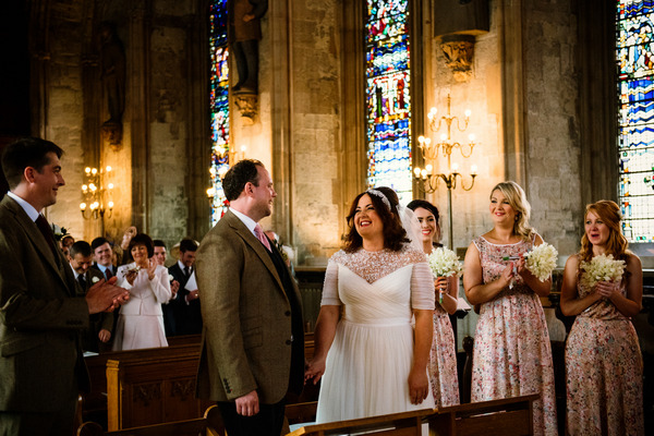 Bride and groom looking at each other in church